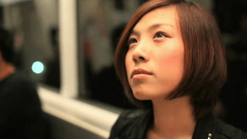 young Asian woman on subway Public Awareness Video NNEDV %page