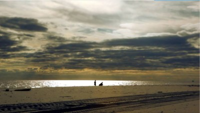 Silhouettes of two people at an ocean beach 400x226 Legacy Story Video %page
