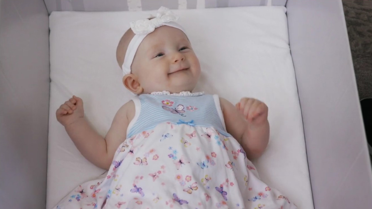 Smiling baby in an award winning safe baby box Business Promo Video %page