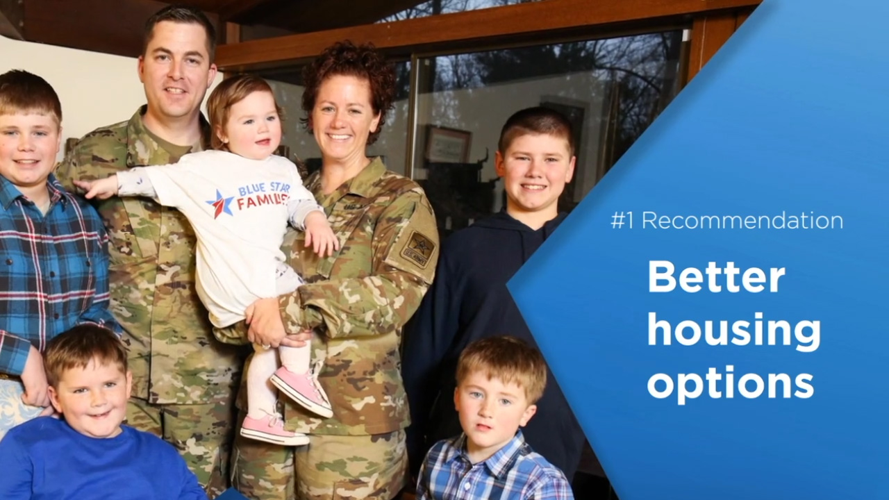 brand video photo showing recommendation and smiling military family with young child wearing a branded t shirt Brand Video %page