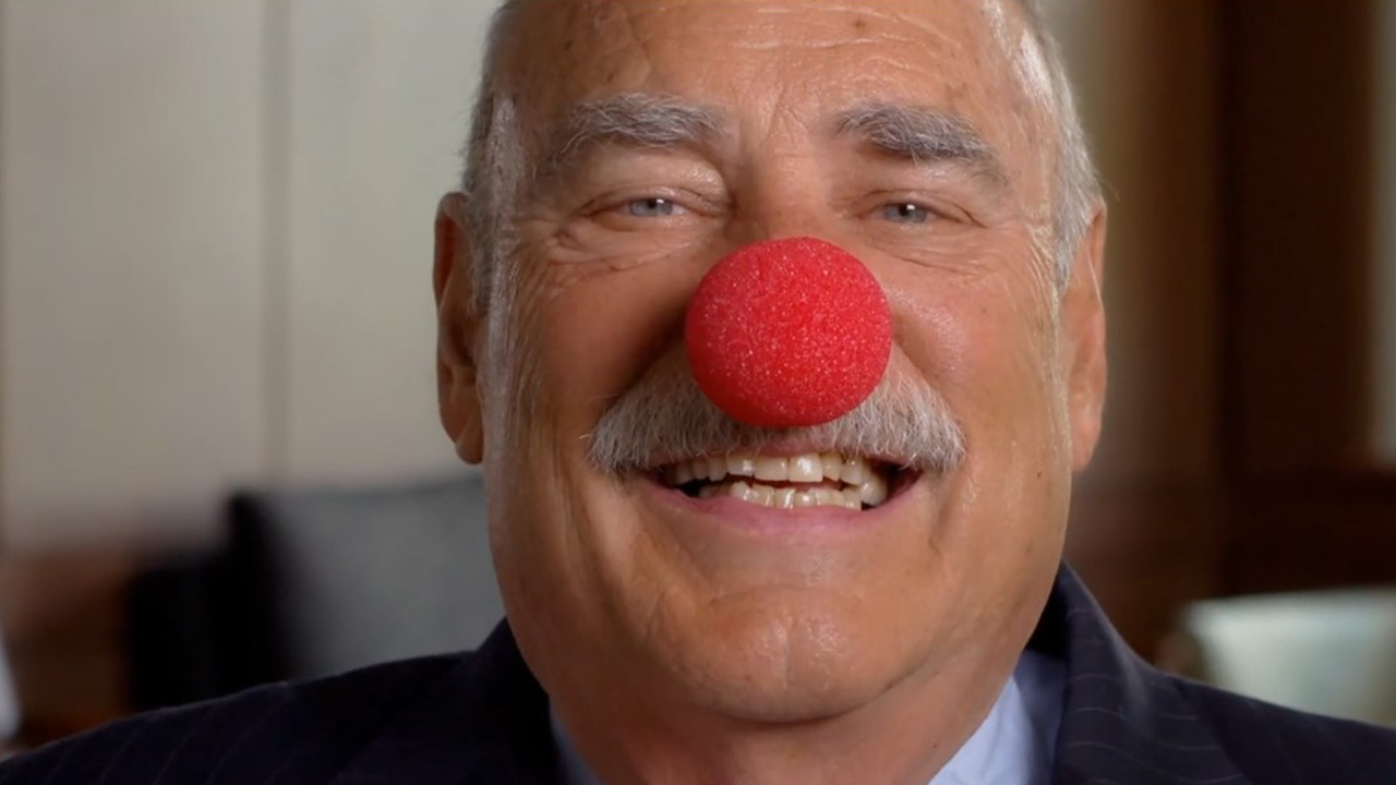 alumni giving video with planned giving donor chuck tatelbaum wearing red clown nose
