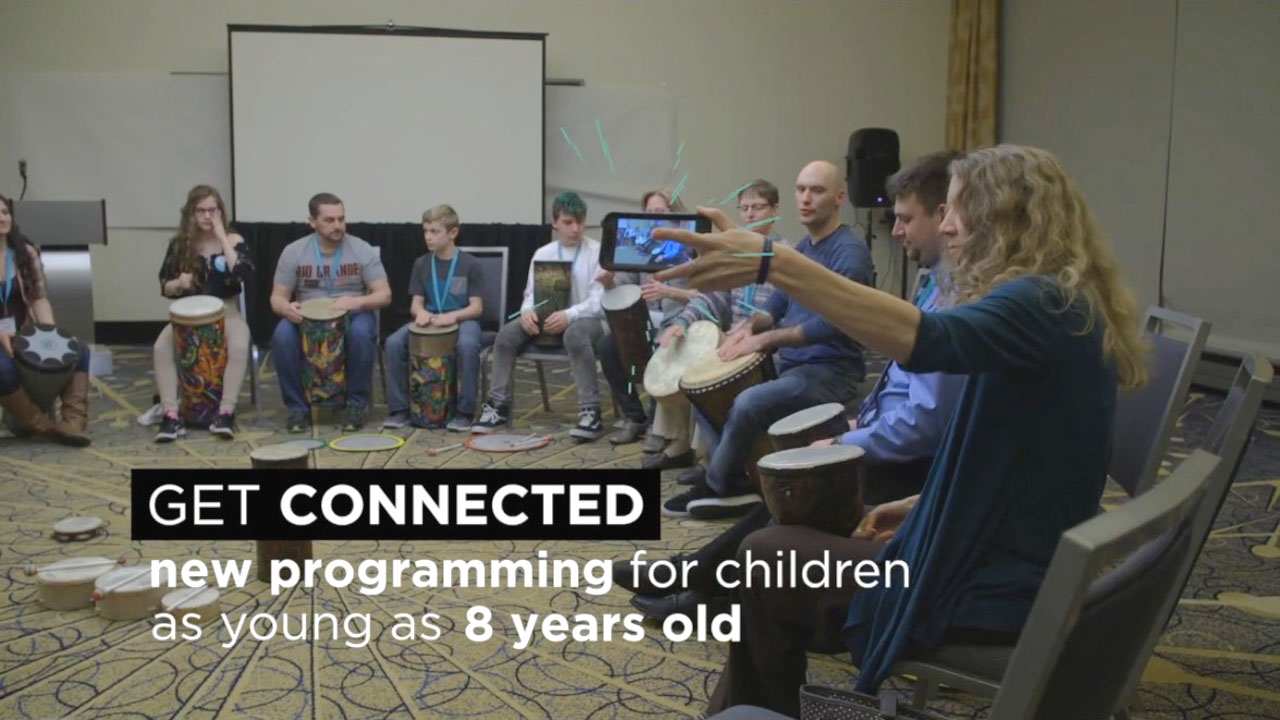 social media video thumbnail of youths teens adults drumming at medical conference